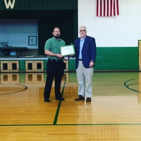 Mr. Brooker receives Award
