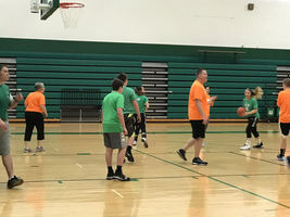 W.E.S. Staff Play Students in Basketball Showdown